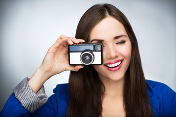 Beautiful woman with vintage camera