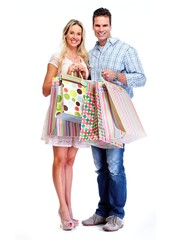 Happy couple with shopping bags.