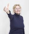 Leinwanddruck Bild - Frau zeigt Daumen hoch
