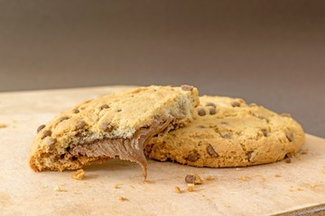 Chocolate chip cookies on a wooden board with copy space