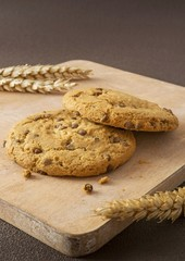 Chocolate chip cookies on a wooden board