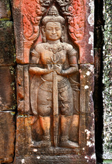 Bass relief wall carving in Angkor Wat, Siem Reap, Cambodia.