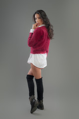 Hispanic fashion model posing at studio