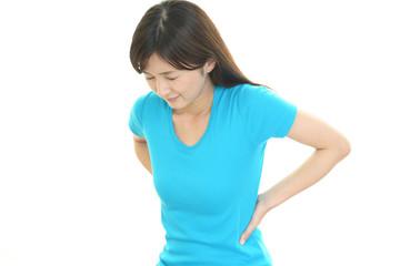 腰痛をうったえる女性
