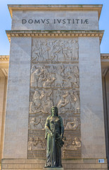 Statue at the entrance of the court of Porto