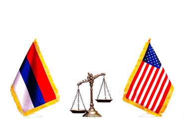 American and Russian flag with scales of justice