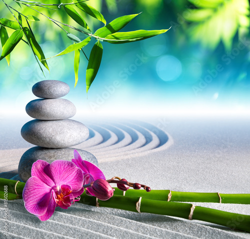 Leinwandbild Motiv sand, orchid and massage stones in zen garden