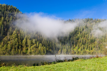 Summer, fog on the river. Altai Mountains.