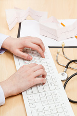 medic works on white PC keyboard
