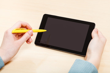 man touches by pen of tablet PC with black screen