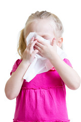 sick child wiping or cleaning nose with tissue isolated