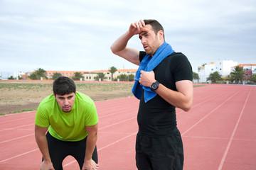 Two runner men resting after exercise