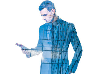 Double exposure of businessman holding tablet and building