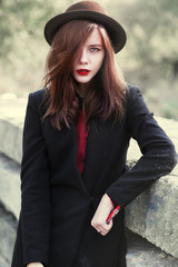 Young sexy girl with red lips wearing a hat