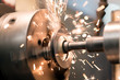 Leinwandbild Motiv Finishing metal working on lathe grinder machine with sparks