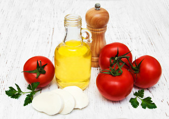 olive oil, mozzarella cheese and tomatoes