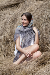 Portrait of a beautiful young woman in a blue scarf
