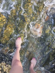 feet on the rock,wave.