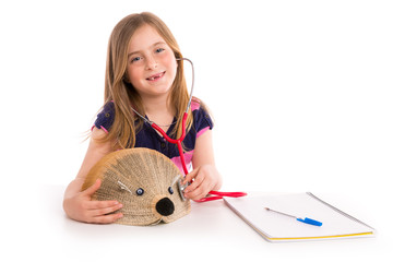 Blond kid girl pretending be doctor with hedgehog