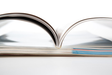 stack of magazines on a white background
