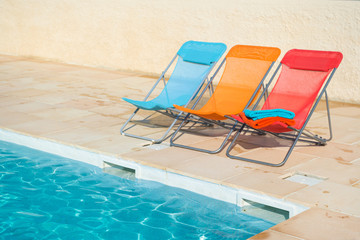 Colorful chairs at swimming pool