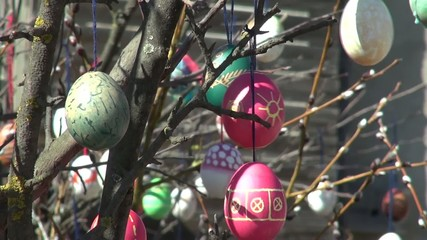Festive background People decorate painted Easter eggs branches