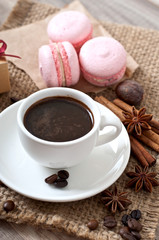 cup of hot coffee and spices, macaroons