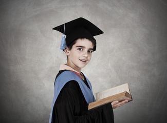 child with graduation robe