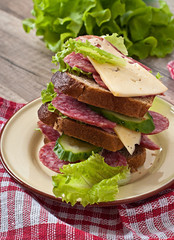 sandwich with cheese and meat sausages