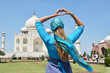 Heart-shaped hands against Taj Mahal. Agra, India
