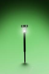 Solar lamp on green energy background