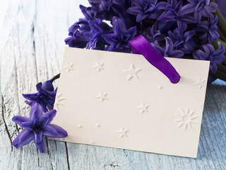 blank greeting card with fresh spring flowers