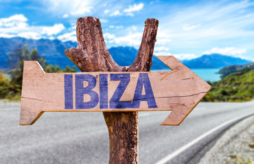 Ibiza wooden sign with road background