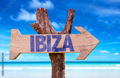 Ibiza wooden sign with beach background