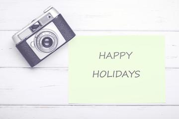 camara de fotos vintage con nota de felices vacaciones