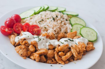 Gyros chicken with rice, tzatziki dressing and vegetables