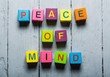 Mind. Peace of Mind wooden sign with a beach on background