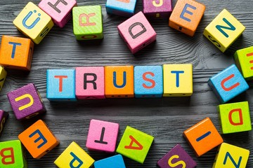 Trusted. Text of TRUST on cubes