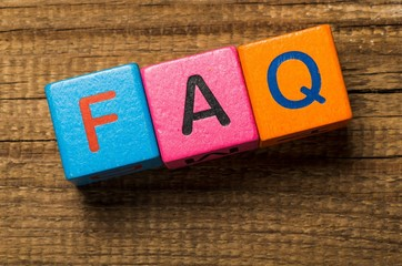 Faq. Concept of FAQ word on wooden colorful cubes