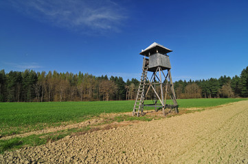 Hunting tower in a field