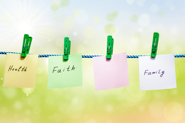Messages written on sheets of paper on green background