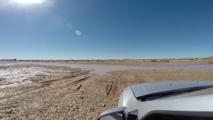 Driving through the ford with a 4wd car.  Morocco, Africa.
