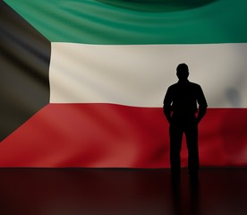 Man silhouette in front of the Kuwait flag