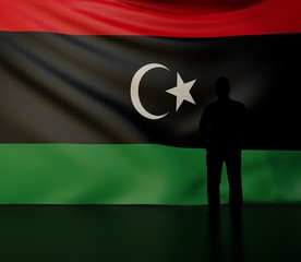 Man silhouette in front of the Libya flag