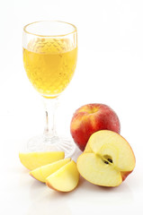 Apple juice with slice of apple on white background