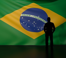 Man silhouette in front of the Brazil flag