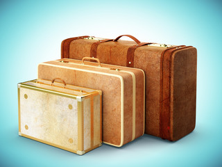 three brown suitcase