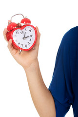 Young woman holding alarmclock.