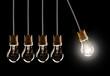 Leinwanddruck Bild - Light bulbs in row with single one shinning