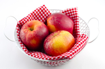 Apples with red napkin in a white basket